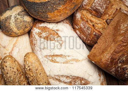 Bread assortment on wooden surface