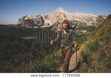 Man Traveler with backpack mountaineering Travel Lifestyle