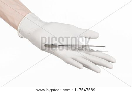Medicine And Surgery Theme: Doctor's Hand In A White Glove Holding Tweezers Isolated On White Backgr