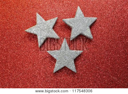 Large Silver Stars On Bright Red Glittery Background