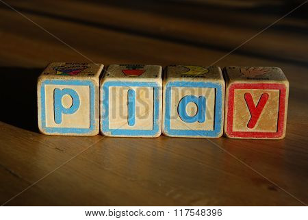 Spelling play with toy blocks