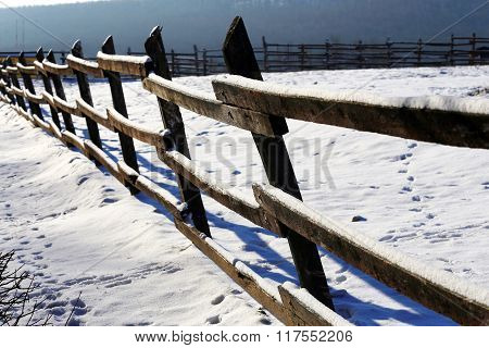 Fresh Snow On Wooden Corral Fence At Winter Rural Scene