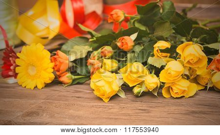 Workplace Of Florist, Making Bouquet. Yellow And Orange Roses On Wooden Background.
