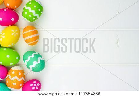 Easter egg side border against white wood