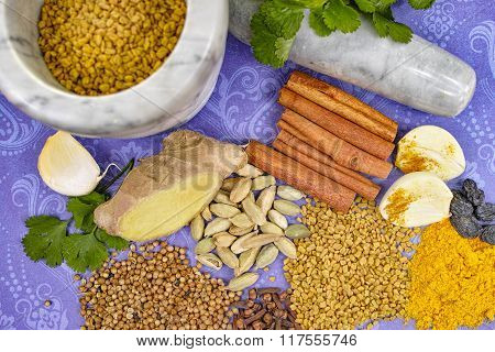 Indian Spices, Fresh And Dried On Purple Background With Marble Mortar