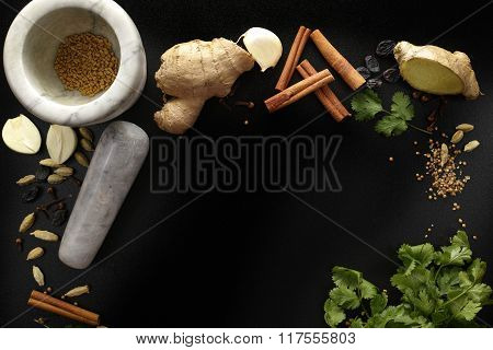 Marble Mortar And Indian Spices, Fresh And Dried On Black Background, Copy Space