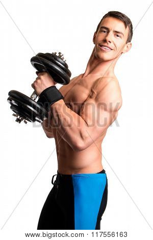 Athletic man with dumbbell. Studio shot over white.