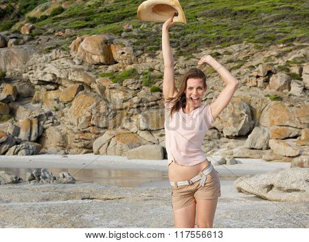 Fun Woman With Hat At The Beach