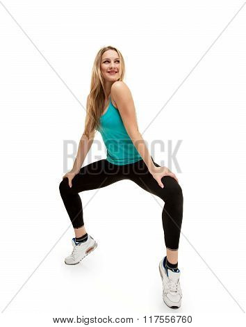 young woman with slim body. squatting on tiptoes
