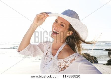 Attractive Woman Laughing With Hat At The Beach