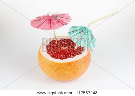 Cut Grapefruit Cocktail With Umbrella, On White
