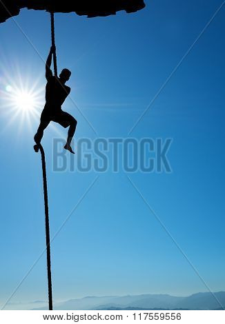 Silhouette Of Rock Climber Vertical Image