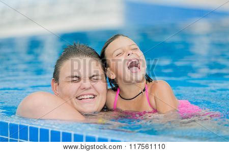 beautiful amazing view of happy laughing smiling children swim and play in pool