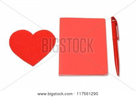 red heart, notepad and pen. valentines day.