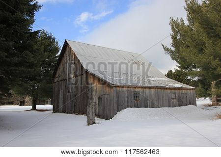 A barn and other barns in winter