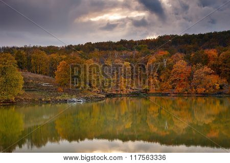 Beautiful Nature Landscape. Autumn Fall Forest Reflected On Lake