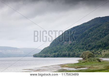 Green Forest Mountains Near River. Beautiful Nature Landscape.