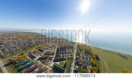 Aerial view of a summer house village at blue sea coast.
