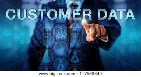 Businessman Pushing Customer Data Onscreen