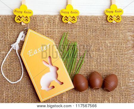 Easter Symbols On Sackcloth Background.