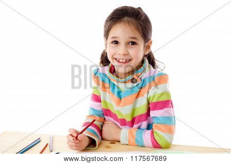 Smiling little girl draw with crayons