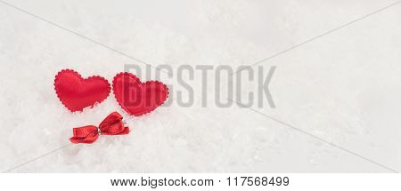 Hearts On A White Snowy Background