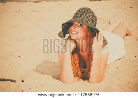 Beauty red haired girl on beach