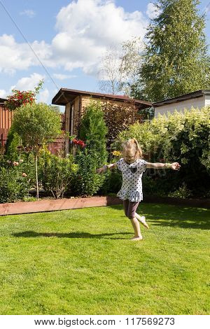 Girl Dancing In Beautiful Blooming Garden