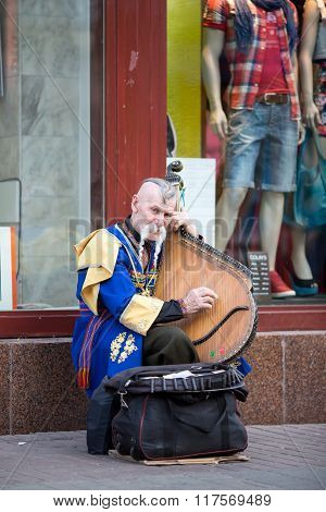 KIEV, UKRAINE - MAY 03, 2013: Street musician in the image of cossack in the national costume