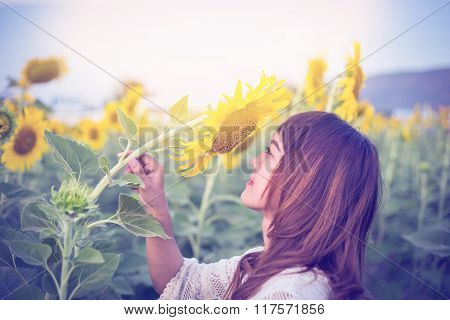 Beautiful Woman Enjoys Blooming Sunflower In The Sunflowers Field Vintage Tone