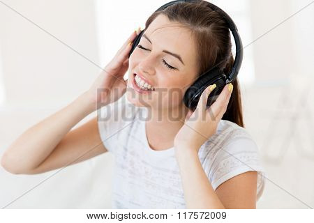 cheerful young teen girl listening to music