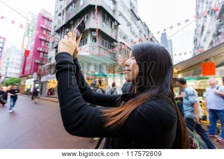 Woman take photo with cellphone