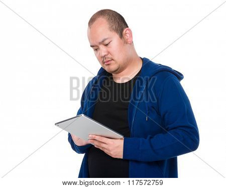 Asian man use of tablet pc