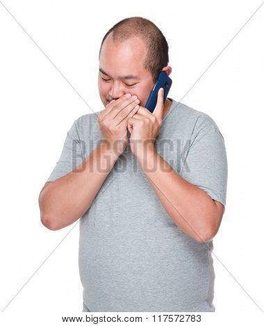 Man talking to phone secretly