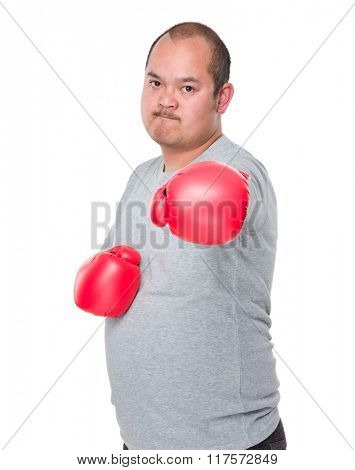 Asian Man wearing red boxing gloves