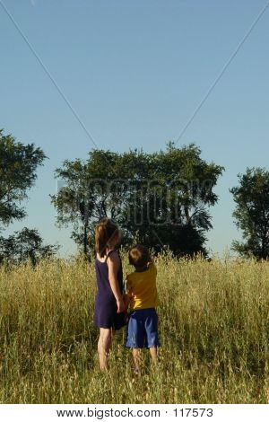 Two Children Pointing At Sky