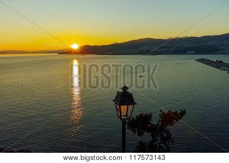 The last rays of the sun in Kavala, Greece
