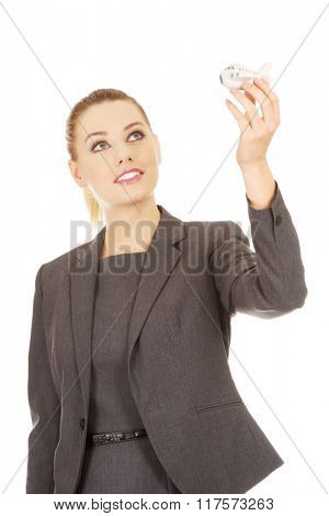 Business woman holding airplane model.