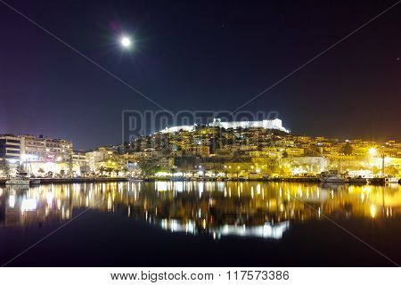 Amazing night photo of Kavala and moon over old town, Greece