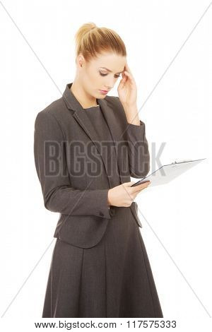Thoughtful businesswoman reading her notes.