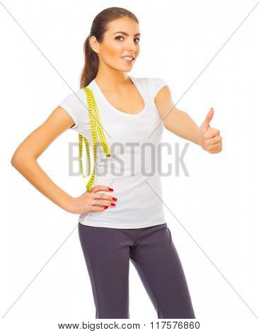 Young healthy woman shows ok gesture isolated