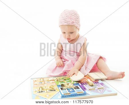 little child baby playing pink dress isolated on white studio shot