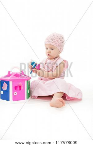 little child baby playing girl pink dress isolated on white studio shot