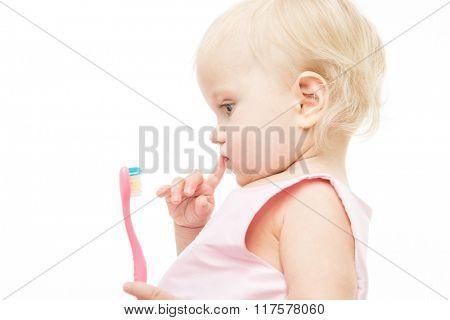 little child baby brushing teeth brush face isolated on white studio shot