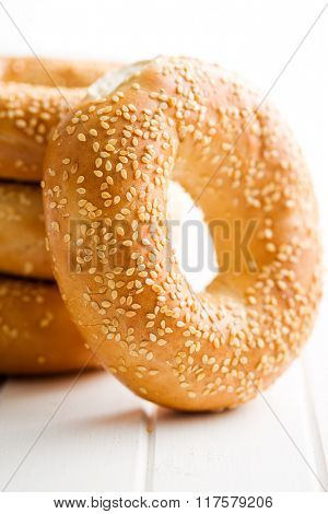 tasty bagel with sesame seed on white table