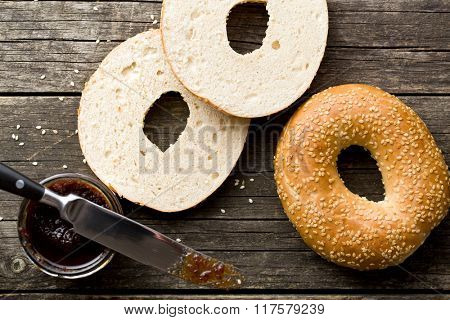tasty bagel with sesame seed on old wooden table