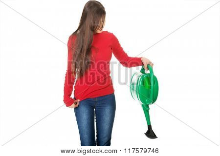 Woman holding a watering can.