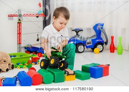 boy playing with car