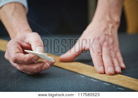 Tailor hands with chalk