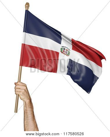 Hand proudly waving the national flag of the Dominican Republic